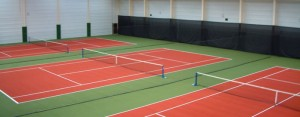 Ready for action. Three of the 11 tennis courts at the Manor Hotel.